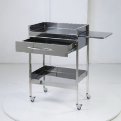 Медицинский столик с ящиком, выдвижной плоскостью и высокими бортами.