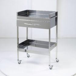 Медицинский столик с ящиком и выдвижной плоскостью с высокими бортами.